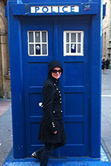 Aimee Maree opening a door to a Tardis in Glasgow